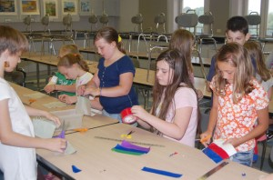 B.R.E.A.K. students working on a craft
