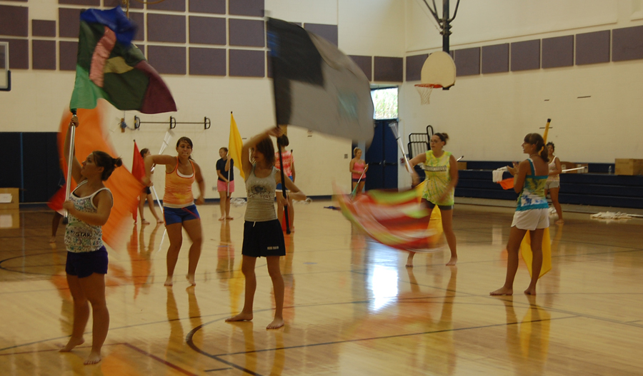 girls practicing with flags