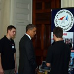 President Obama talks with PM team members