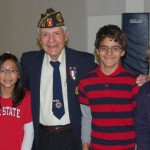 A veteran with students