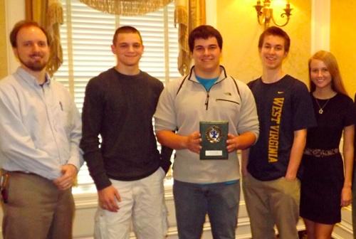 Pictured are (left to right) Penn Manor HS Economics Teacher: Mr. Chris Meier, Penn Manor HS Students Lake Heckaman, Anthony Cazillo, Mark Dano, Lauren Pironis