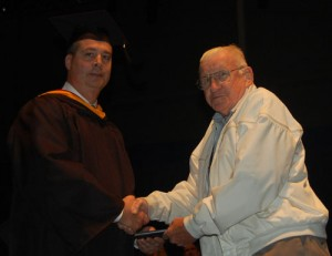 special graduate, Mr. Philip Fisher, a Korean War veteran who received his diploma