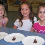 edible mice using a Hershey's Kiss, chocolate covered cherry, and almonds