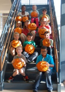 Students and their carved pumpkins