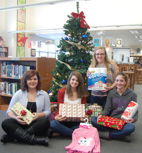Pictured are (from left to right), Giving Tree Co-Chair, Katie Stringer, Student Council Vice-President, Rachel Shelley, Student Council President, Lindamarie Olson, Giving Tree Co-Chair, Haley George