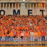 more than 800 students dressed in orange gathered in the gym in Greg's honor