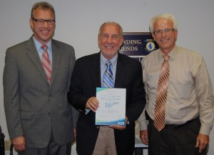 Richard Frerichs, center, receives a commendation from, left, Penn Manor superintendent Mike Leichliter and school board president Kenneth Long