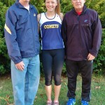 Greta is pictured with her coaches, Tom Ecker, left, and Bob Ulmer