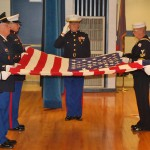 folding and saluting the flag