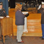 Marticville principal Christine Santaniello accepting the flag that was flown during an air assault mission in Afghanistan