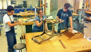 From left, Anthony Fahnestock, Krina Cruz and Gage Dearolf work on their furniture projects.