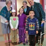 Teachers, from left, Megan Szentesy, Amy Bittenbender and Jeff Heiney, centenarians for a day, pose with students.