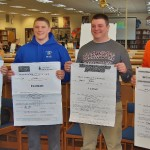 Football players with their signing letters.