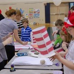 "Children make hats at the ""Cat in the Hat' table."