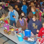 Kids check out the items for auction