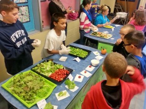 students displaying their garden food