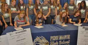 Field hockey players sign letters of intent to play in college.