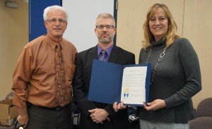 From left, school board president Ken Long, Manor principal Dana Edwards and Manor Title 1 academic support teacher Amy Niemkiewicz.