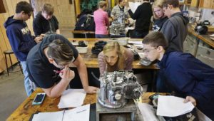 Meagan Slates helps her students identify engine parts in an Intro to Ag Mechanics class.