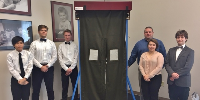 Members of the PMHS STEM team, from left, Kevin Ward, Ryan Mahoney, Cole Yecker, Calle MacDonald, Joshua Adams and teacher Barry Groff pose with the fire barrier prototype.