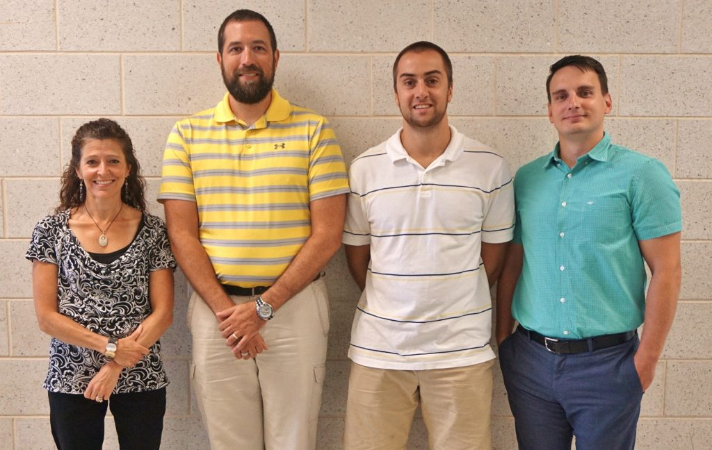 From left, new teachers Vicki Fafel, Joel Ernst, Mitch King and Jeb Thompson.