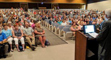 School board president Ken Long addresses the crowd.