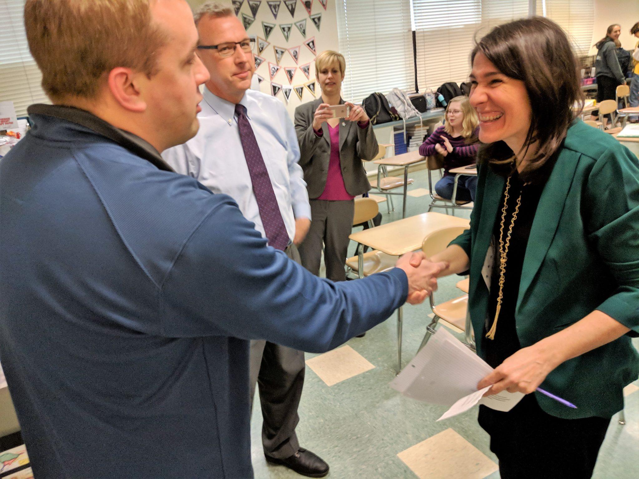 Cutler congratulates Maria Vita.