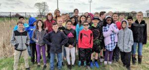 Teacher Katie Lutz and students.