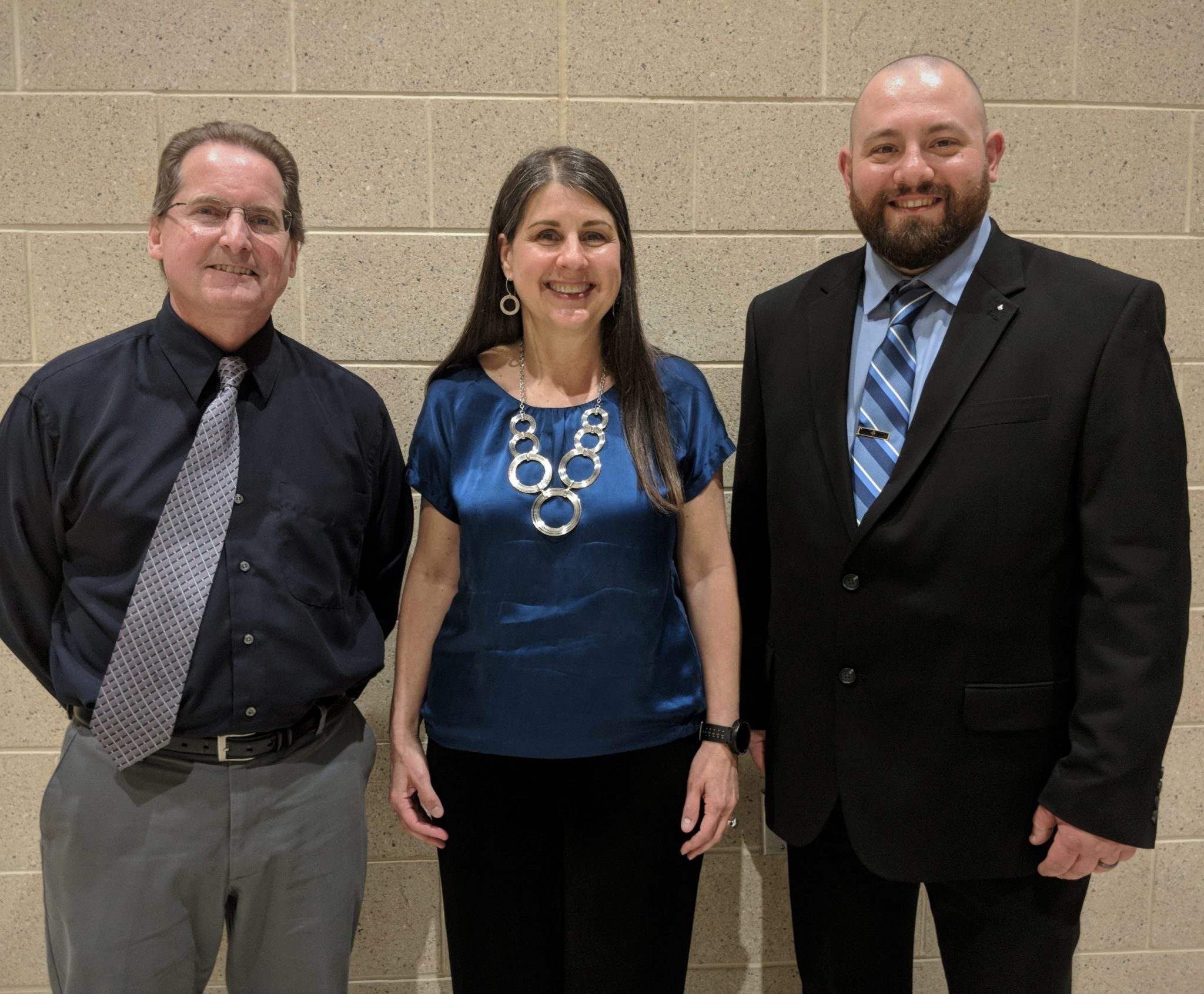 Outstanding employees James McGlynn, Lisa Roth Walter and David Sellers.