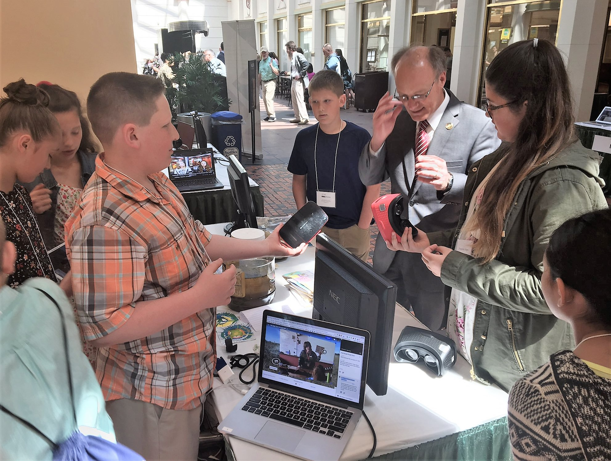 Hambright students explain their VR environmental project to state Rep. Brett Miller.