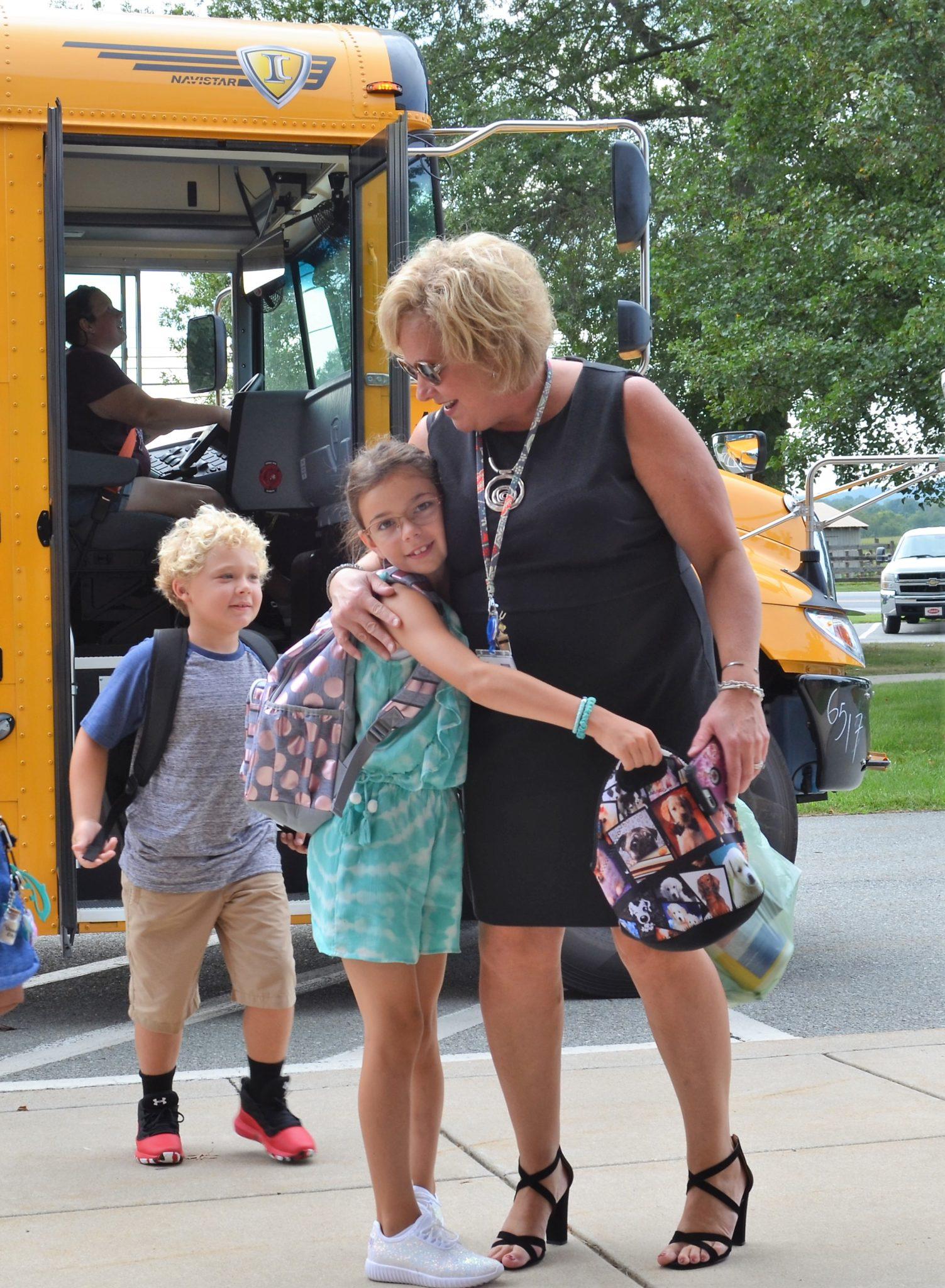 Principal Carly McPherson greets a student.