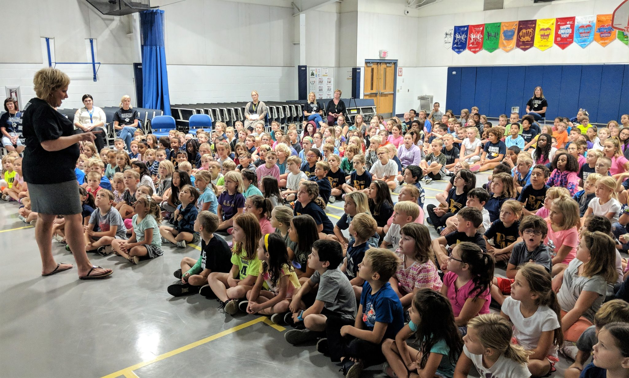McPherson addresses students in an all-school assembly.