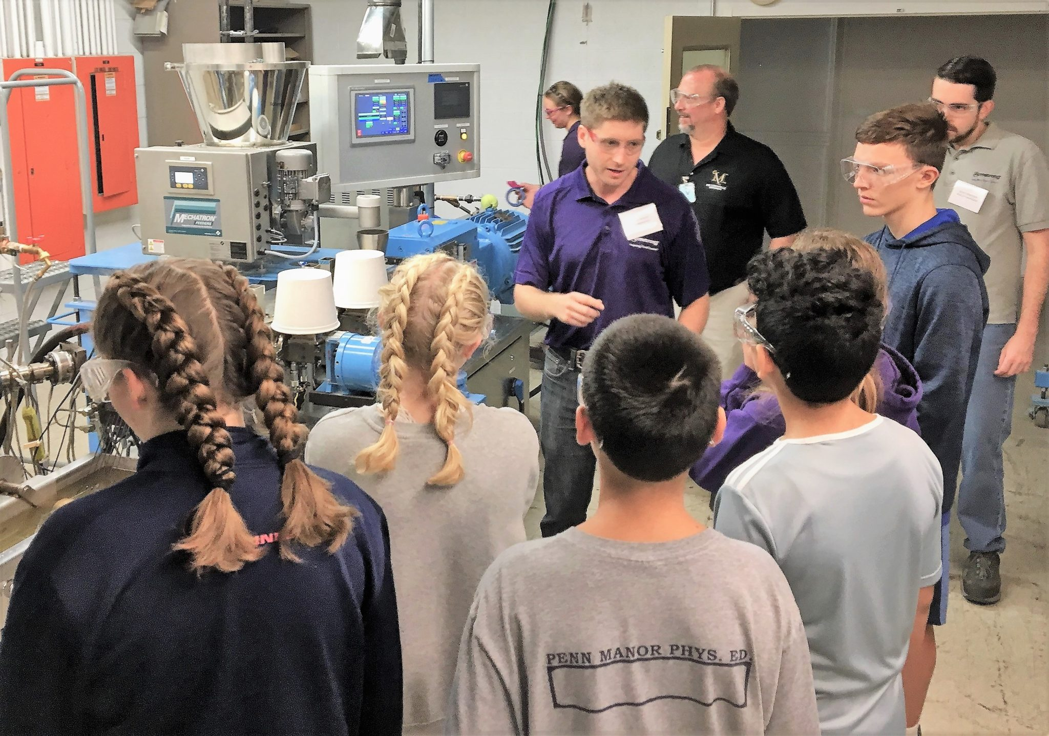 Middle school students touring Armstrong plant