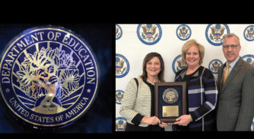 Blue Ribbon plaque and Lisa Suydam, Carly McPherson and Mike Leichliter.