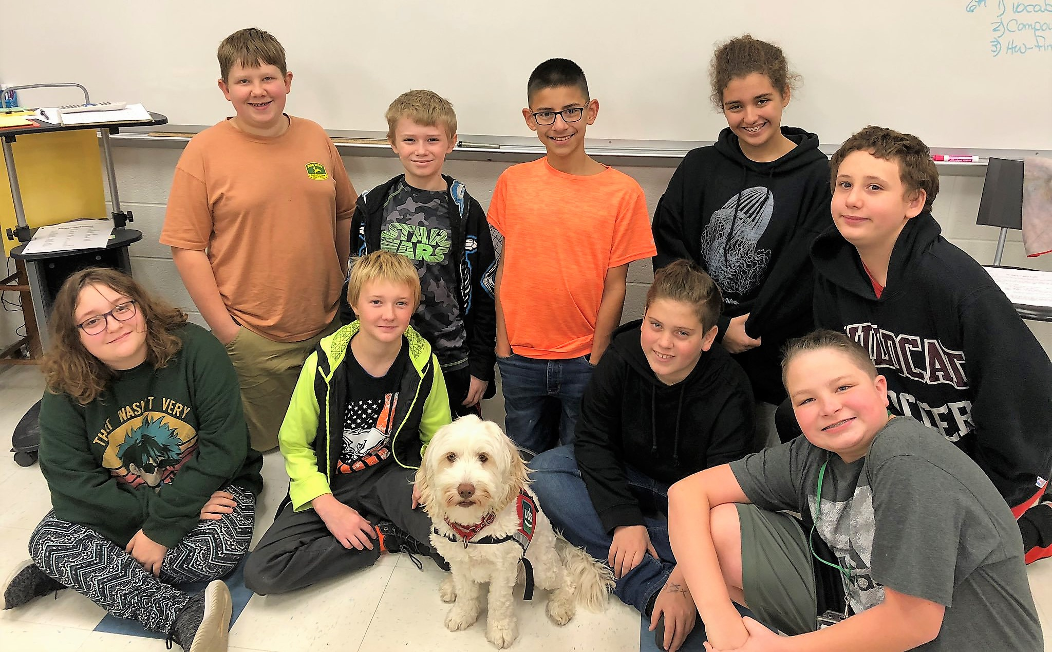 Therapy dog Kiwi with students at Marticville Middle School