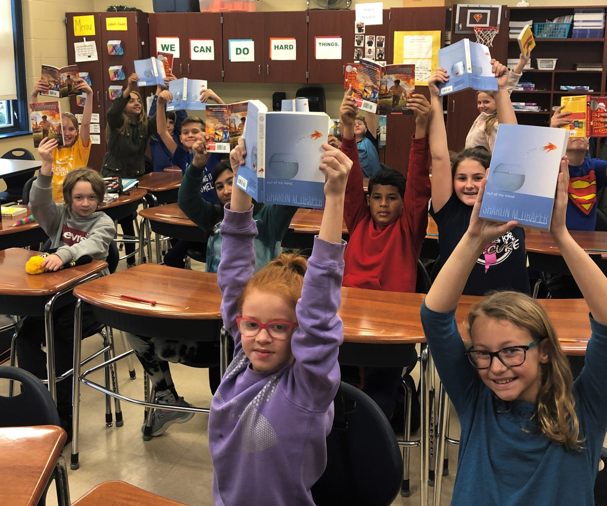 Central Manor students with new books