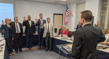School board members take the oath of office.