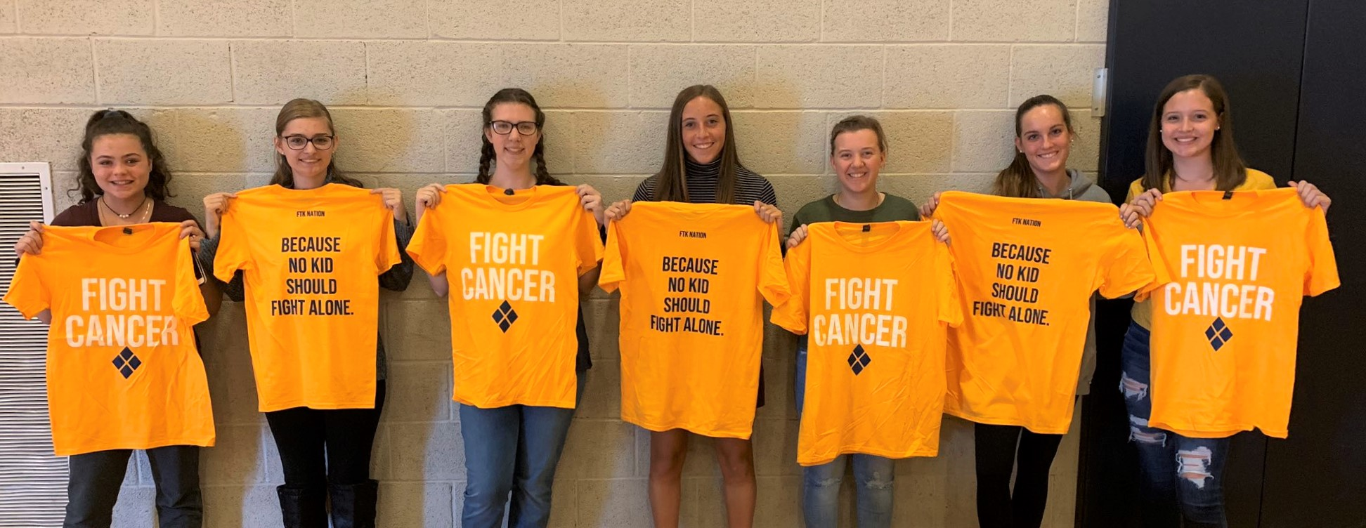 "MiniTHON T-shirts: ""FIGHT CANCER because no kid should fight alone."""