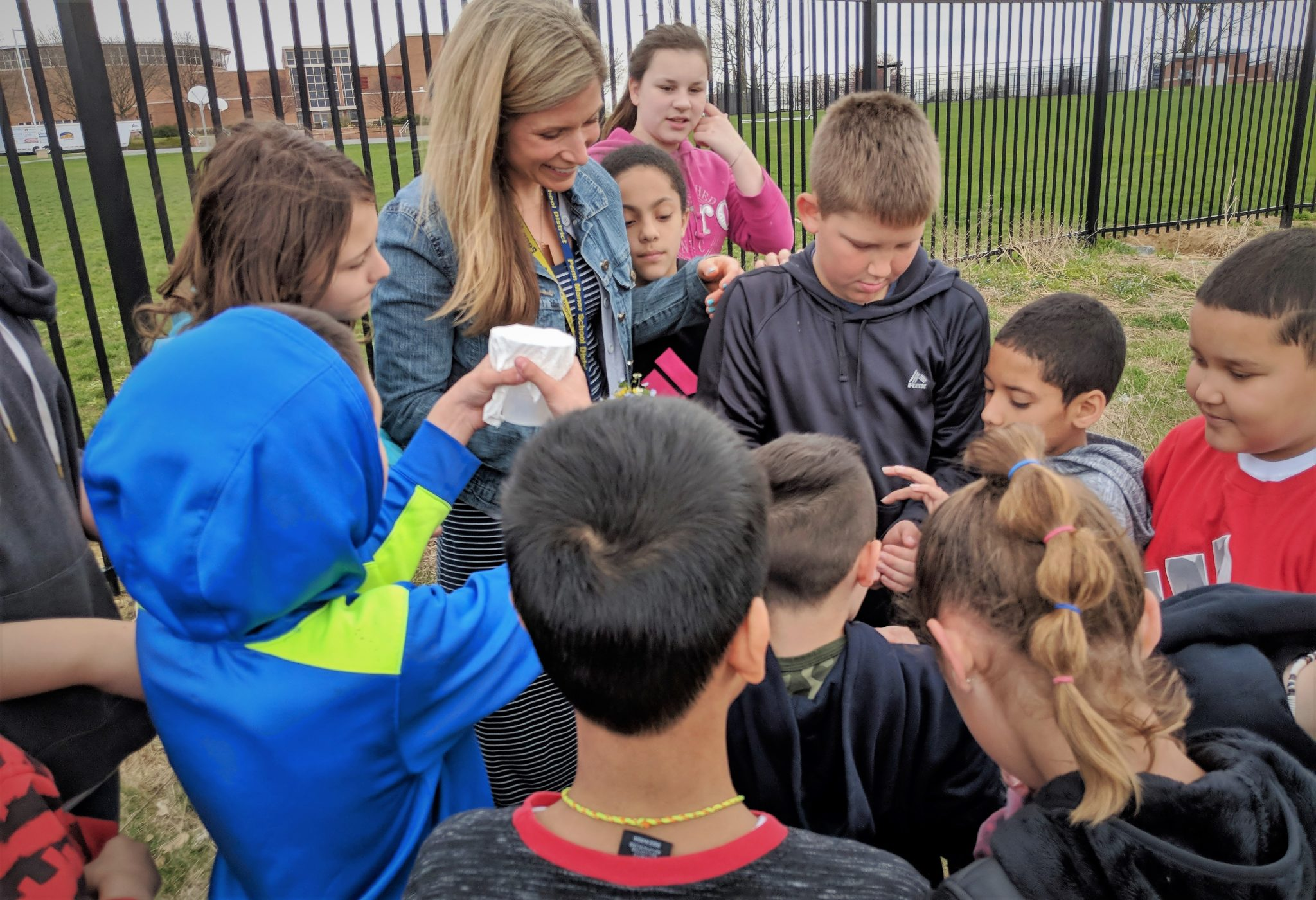 Katie Harnish with students outdoors