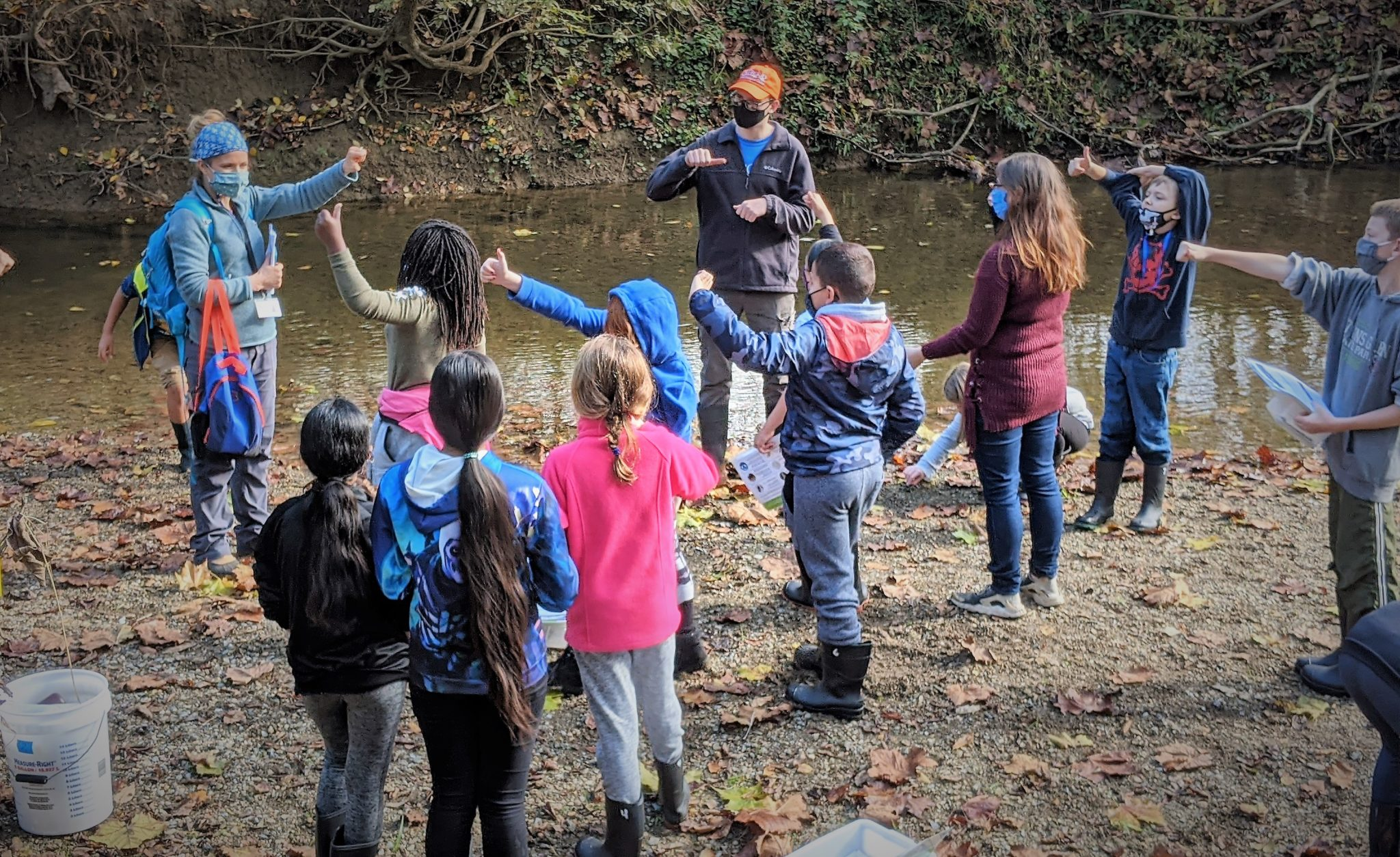 Mrs. Harnish and student participate in a stream study.