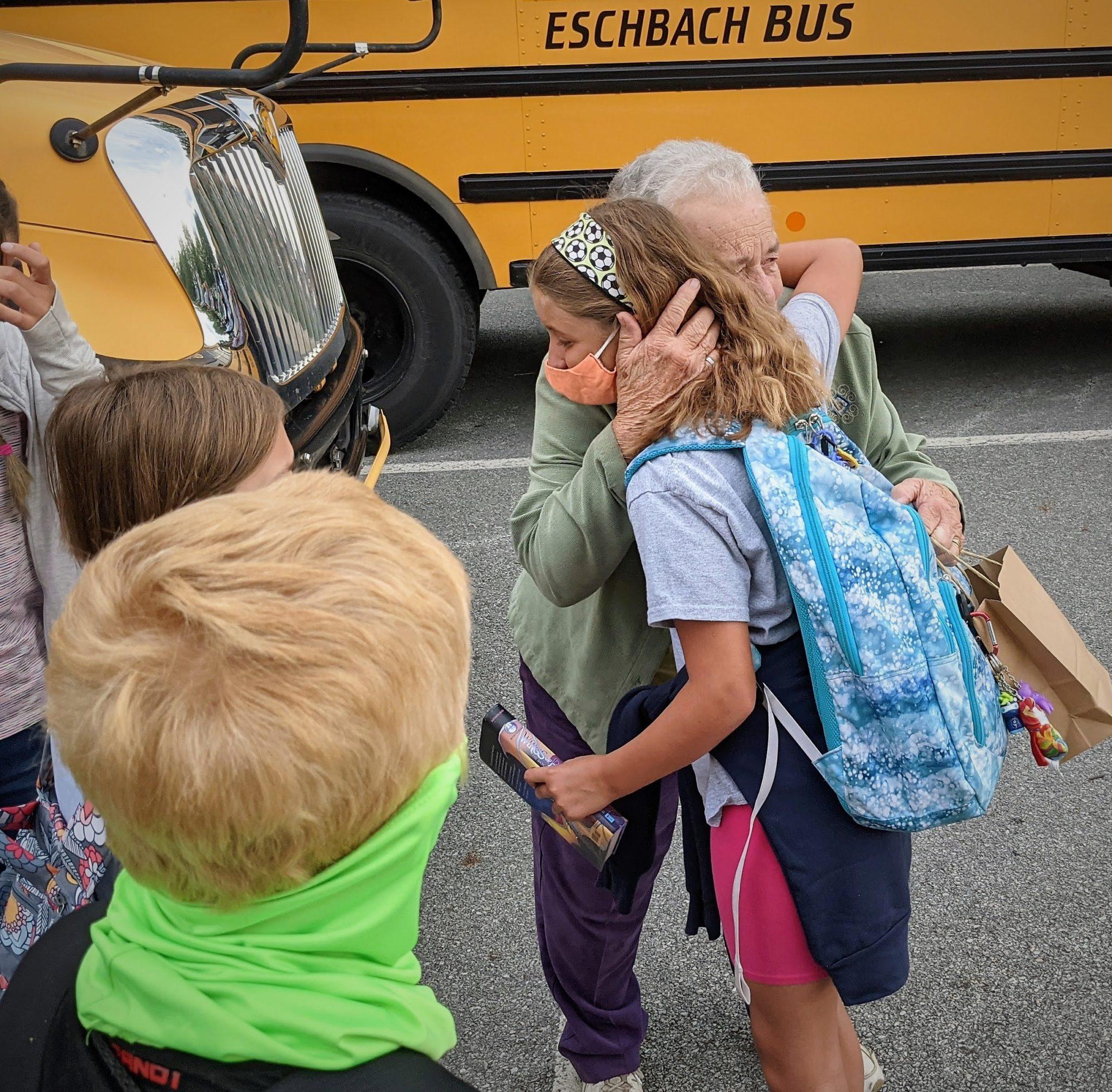 Ella Sensenig hugging a student