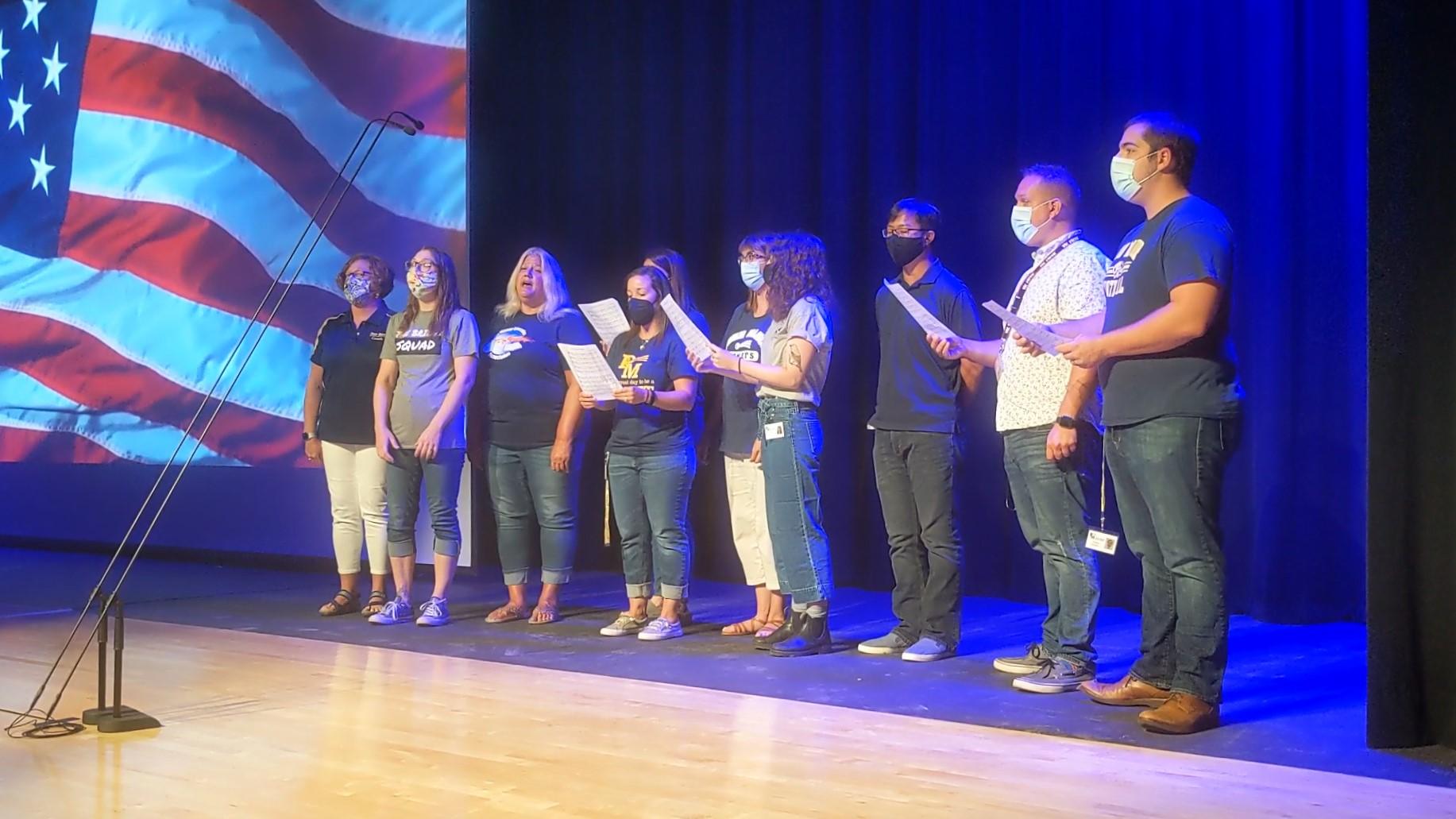 """Music teachers sing """"Star Spangled Banner."""""""