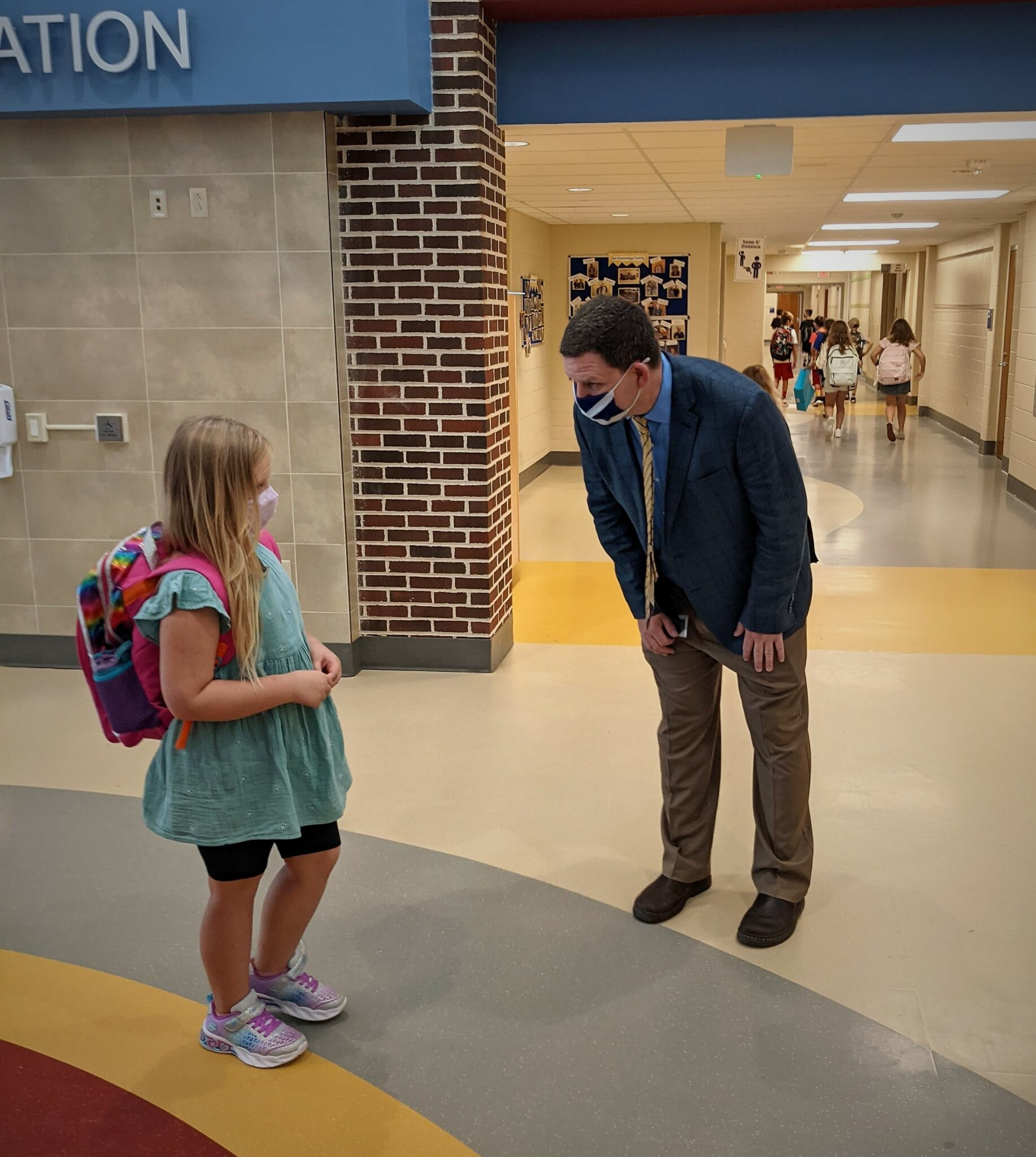 Principal Scott Keddie with a student at Conestoga Elementary